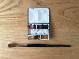 Paintbox and brush