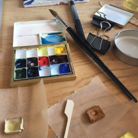 Cakes of colour removed from palette with blunt stick