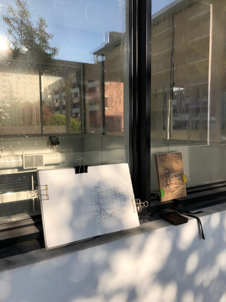 Sketchbook on the window of the swimming pool
